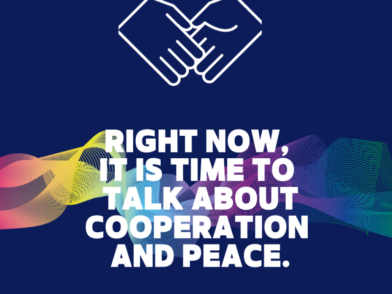 """Text saying """"Right Now, it is time to talk about cooperation and peace"""" on a navy background with two hands shaking"""